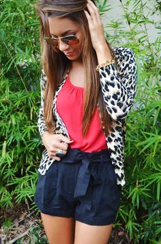 Leopard cardigan, pink tank top, and navy blue shorts