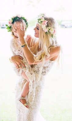 Wanting more? So are we! This is real life, we love photos like these. How precious are their matching dresses and floral crowns? . . #bohowedding #outdoorwedding #fallwedding #lacedress #floralcrown #bohemian #love