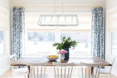 Patterned drapes and neutral walls