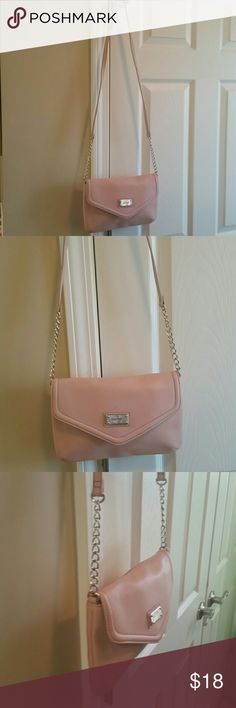 Nine West!!Purse with Cross Body Long Strap... Lite Pink purse with inside zip compartment,  close button  and long 24inch strap ... it's very simple clean..no scars or marks.. Nine West Bags Crossbody Bags