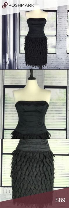"""BCBG MAX AZRIA Runway Corset Organza Petals Dress Black satin strapless, Sheath, straight neck, corset bodice, stitching around cups. Upper edge of dress is lined with rubber to help it hold tight to your skin. Ribbon lined at the top of the bodice. Exposed back zipper. Made of individually sewn on organza petals. 53% silk, 42% cotton, liner: 100% silk. Measurements: Chest (pit to pit): 15"""", Waist: 13"""", Hips: 16"""" (hem of corset), Total length (arm pit of dress to hem): 31"""". Very good…"""