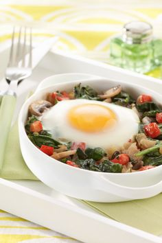 Grated Parmesan and fresh veggies give your morning eggs a Mediterranean twist.