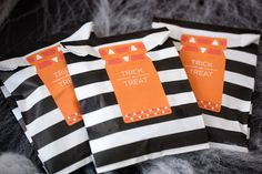 Striped sacks: Download a cute label template and place on striped goody bags! #halloween #printable #treatsacks