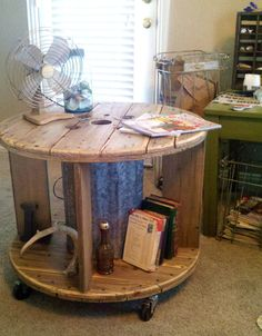 Repurposed Spool Industrial Rustic Coffee Table or End Table with Casters. $325.00, via Etsy.
