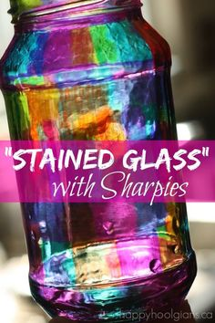I have plenty of glass jars around for the kiddos to scribble on --- Create the look of stained glass with Sharpie Markers and a Jar