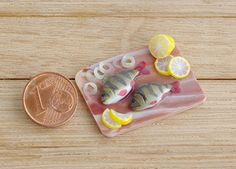 Miniature realistic river perch fish with by Irinaminiatures