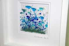 This Cornflower picture is made in my kiln in my home studio in North Wales. The piece is then fired for 12 hours at approx 800c to fuse the glass and paints together. The frame surrounding my picture is an off white which sets off the blue perfectly. Glass tile is approx 10cm x 10cm, surrounded by a single mount. The frame is approx 25cm x 25cm. Each piece is individually painted and made so variation from the picture should be expected. For shipments outside the U.K. Please provide a…