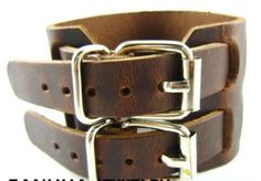 Men's leather cuff-$10  Double buckle leather bracelet. About 10 inches long and 1.96 in. Wide