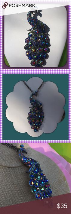 Peacock Necklace Gorgeous peacock necklace- you can't take your eyes off of it!  By Cara Ny. It is a beauty. All stones are in tack - it looks like it kinda changes colors with your outfit. Beautiful crystals. You can change the size of the necklace. 30 inches with a 4 inch extender. The chain is a darker color Cara Na Jewelry Necklaces