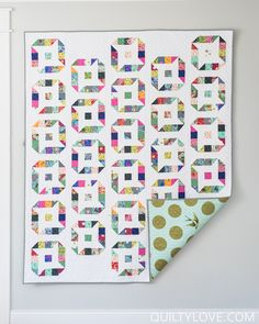 ninja stars jelly roll quilt by Emily of quiltylove.com. Uses Slow and Steady fabric by Tula Pink to create this fun star quilt.