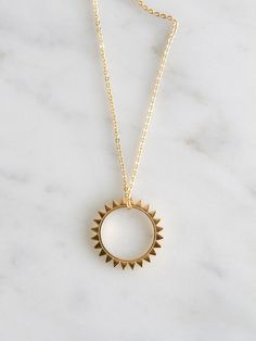 """""""I adore the simple shape of this sunshine! I have this myself and the quality of this necklace is really nice. A piece I can see myself wearing it for a long time."""" -@Jeanne / Shop Sweet Things"""
