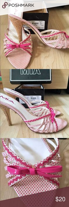 "MIA Women's White / Pink Open Toe Pump Size 10 The MIA Bombshell is the perfect addition to your summer wardrobe! Color: ""Bubble Gump"" (Fuchsia Pink and Ivory) Materials: Fabric, Leather and Cork This beautiful and stylish slide sandals are made with polka dot fabric straps decorated with solid trim, a cute bow detail, cork heels, open toe and leather sole. Originally purchased for $69.95 and worn for a fashion show only, they look like new :) MIA Shoes Mules & Clogs"