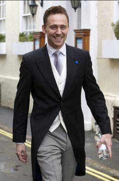 Tom Hiddleston at Benedict Cumberbatch's wedding :) - click through for more