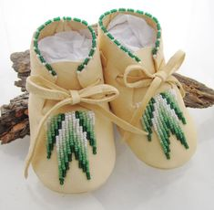 Authentic Native American Made baby moccasins of soft white deer hide for either boys or girls with a traditional southwest beaded design.