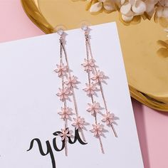Add feminine flair to your ensembles with our ROSE GOLD FLORAL LONG DANGLE EARRINGS. These fabulous earrings feature a long floral drop design, crafted in rose gold tone finish and decorated with rhinestones, offering a dramatic dazzling look. Cute Earrings, Bridal Earrings, Gold Earrings, Drop Earrings, Chandelier Earrings, Earrings Crafts, Rose Gold Dangle Earrings, Silver Chandelier, Amethyst Jewelry