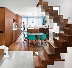 "Architect Drew Mandel updated a house in Toronto to look modern and cozy. The clients desired a warm material base for the interior so Mandel used American walnut for the flooring millwork and staircase. Loire limestone covers the landing below the steps and Calacatta marble clads the kitchen counters and island. See feature ""Reinventing a Traditional Edwardian near Lake Ontario  on dwell.com right now... Photo: Shai Gil  Architect: Drew Mandel / #modern #renovation #dwell #ontario"