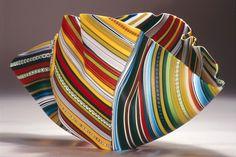 "Polychrome Striped Bowl Form (2013) // Murrines fusionnées et thermoformées, 17,5 x 36,5 x 14 cm / Fused and slumped glass murrini, 7"" x 14"" x 5.5"""