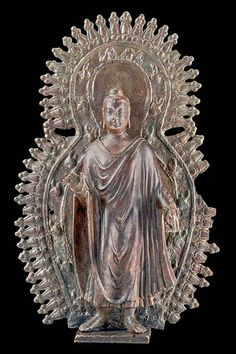 """Bronze sculptures of the Buddha executed in the Gandharan style and of such substantial size are very rare. This beautiful recent acquisition is now on display in """"Masterworks: Jewels of the Collection."""" Ruben Museum"""