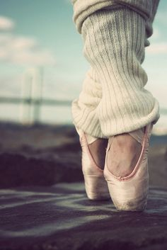 Pointe shoes and leg warmers.