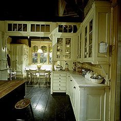 "It's not difficult to see why Victoria featured the spacious, old-house style kitchen given the elaborate cabinetry with brackets, corbels and spandrels over upper cabinets. Standefer also noted  that glass in the cabinet doors was rippled like antique hand-blown glass as ""it casts a different light,"" to help the overall effect."