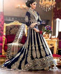 Regal deep blue and gold desi bridal gown with lehnga bottom, I love the accent of the red rose