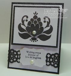 Card Supplies:  Cardstock: Whisper White, Basic Black   Inks: StazOn Jet Black   Tools: Big Shot Machine, Stripes Textured Impressions Folder, Lace Ribbon Punch, Decorative Label Punch, Stampin' Dimensionals   Accessories: Large Pearl Basic Jewels, Frost Shimmer Mist Paint   Stamps: Ornate Blossom, Love & Laughter