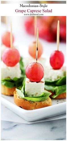 Macedonian-Style *Grape Caprese Salad - light, fresh appetizer-salad with red grapes, feta and spinach set atop slices of ww garlic toast. Or use organic grape tomatoes. Cold Appetizers, Appetizer Salads, Holiday Appetizers, Appetizer Recipes, Party Recipes, Delicious Appetizers, Italian Appetizers, Party Appetizers, Salade Caprese