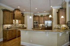 Kitchen color. Pennant lighting. Crown molding. Wood floors.