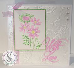 Designed by Marie Jones - Spectrum Noir Sparkle – Cosmos, Emerald Green, Moonlight & Crystal Clear - Stampendous Cosmos Spray stamp - Watercolour card - Centura Pearl Snow White Hint of Silver - Embossalicious Regency Swirls folder - Sara Signature Butterfly Lullaby With Love die - VersaMark ink & White embossing powder - Collall All Purpose & 3D glue #crafterscompanion #spectrumnoir #flower #handmade #craft #card