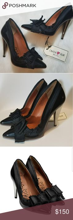 Lanvin H&M Black Patent Leather Satin Bow Pumps ***THIS IS LIMITED EDITION...SOLD OUT***  Up for sale Lanvin H&M Black Patent Leather Satin Bow Pumps Shoes High Heel, heels are chrome color.  Size 8?  Used once for photo shoot, practically new..check out pics. Lanvin Shoes Heels