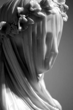What an amazing piece of sculpture! The veil appears translucent