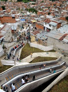 The recently installed outdoor escalators at Comuna 13 shantytown, one of the most poor and violent neighborhoods in Medellin, Colombia, as part of an urbanization plan to improve living conditions of residents.  Thanks to the 384-meter-long (28-story-tall) escalator, a steep climb that would take the residents about 35 minutes to scale, can now be surmounted in less than six minutes.