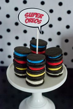 Love how they filled these oreo's to match the party! Easy and inexpensive! Superhero Party on a Budget via Kara's Party Ideas | Kara'sPartyIdeas.com #Superhero #BudgetFriendly #PartyIdeas #Supplies #food