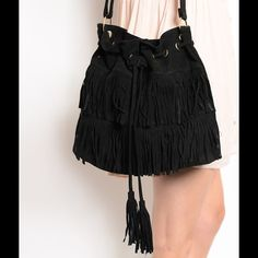 COMING SOONCassiterite Black Fringe Bag Festival ready black faux suede fringed shoulder bag. I offer 25% off 2 items, so pair this item with another fabulous piece and grab these up before they're all gone  This item is , direct from the manufacturer without the specific store tag.  Price will be $38 Paicar Concepts Bags Shoulder Bags