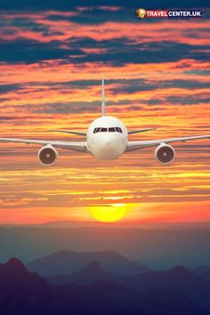 A plan nearing an airport in a dramatic evening while the shades of orange, red and blue blend in with the setting fireball into the valleys. #flights #sunsets #flightdeals #itsallabouttravel #travelcenteruk