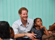 One young girl happily sat next to the prince as they heard from the children living at th...