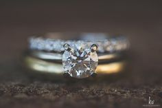 Beautiful photo of the wedding rings, including a classic round diamond engagement ring.