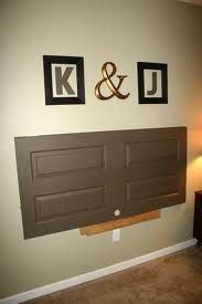 good idea to use an old door as a headboard...I would paint it bright for our place!