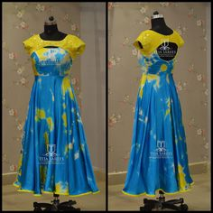 TS-DS- 524 Available. Beautiful yellow and sky blue color combination die print gown. For orders/queries Call/ whats app on 8341382382 or Mail  tejasarees@yahoo.com.