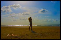 the sea, the sun, the woman