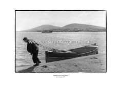 This stunning print caputes the beauty of Valentia Island in just one black and white photo. This photo shows a man pulling his boat from the water after what is presumed to be a hard days fishing. Rowing, Photo Archive, Island County, Dublin, Irish, The Past, In This Moment, Black And White, February