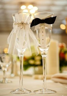 Bride & groom champagne glasses during the toasts