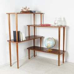 Corner Shelves Eliminate Dead Space Renate Grey Bookcase from Overstock, $389.99.