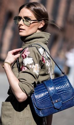 Who made Olivia Palermo's blue handbag, aviator sunglasses, and green floral jacket?