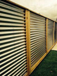 Corrugated-metal-fence-panels
