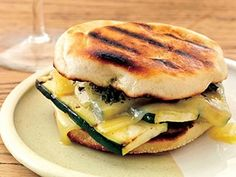 8 Exciting Grilled Cheese Recipes--- Zucchini grilled cheese-     1 packed cup basil leaves     1 large garlic clove, coarsely chopped     1/2 teaspoon hot smoked paprika     3 tablespoons extra-virgin olive oil, plus more for brushing     Salt     1 8-ounce zucchini, cut into 4 lengthwise slices     4 English muffins, preferably Bays split     4 ounces Gruyčre or Appenzeller cheese, cut into 8 thin slices