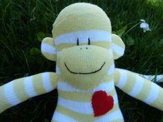 sock monkey FREE HEART patch sock monkey by socksandmonkeyhugs, $14.00 Sock Monkey Baby, Monkey Doll, Neutral Socks, Wooden Music Box, Striped Socks, My Socks, Dinosaur Stuffed Animal, Patches, Plush