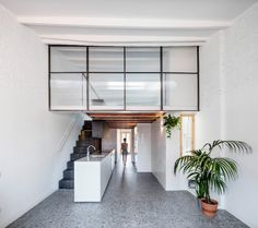 The Barcelona-based studio peeled back the existing ceiling slabs, revealing the attic area and enabling the architects to expand the single-level apartment – named La Dominique – into a two-storey loft with a bedroom on the second floor. Attic Renovation, Attic Remodel, Attic Spaces, Attic Rooms, Mezzanine Floor, Attic Floor, Slanted Walls, Journal Du Design, Attic House