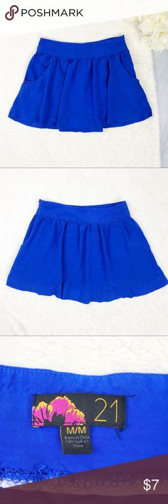 Forever 21 Skirt Forever 21 Skirt Size M Great Used Condition! Zips on the side! Has pockets! ***pic 4: small bleach stain  Measurements:  - across the top: 14.5 in. - down the side: 15 in.  Materials: - 100% rayon   MAKE AN OFFER!!! Forever 21 Skirts Mini