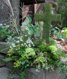 All green, mossy, Celtic cross arrangement for an Irish funeral.  Worcester florists - Sprout